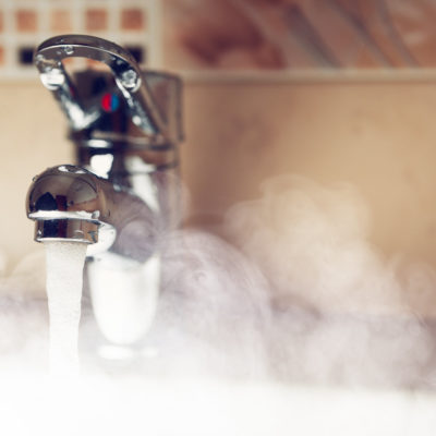 Photo of a faucet with hot steamy water coming out